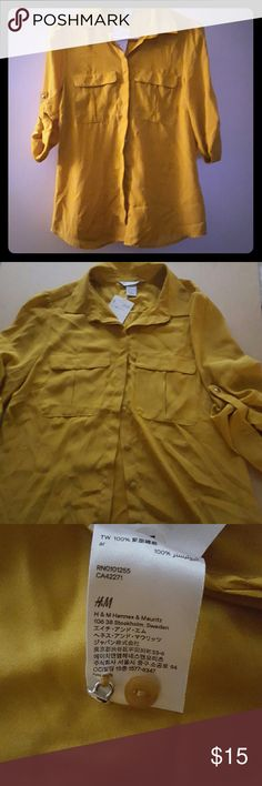 NWT. Mustard Button Shirt Pretty mustard button down shirt. Material is flowy. Perfect color for the fall. Never worn comes with extra buttons. H&M Tops Button Down Shirts