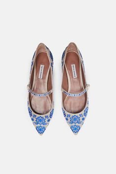 Pointed-toe flats have long been at the core of Tabitha Simmons's collection, and these especially elegant Mary Janes emphasize their streamlined shape and natural linen with vibrant blue embroidery and a single button closure. Finishing touches include a leather sole and padded insole for wear-all-day comfort.