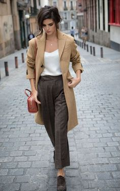 Shop this look on Lookastic:  http://lookastic.com/women/looks/oxford-shoes-wide-leg-pants-crossbody-bag-tank-coat/7605  — Dark Brown Suede Oxford Shoes  — Dark Brown Plaid Wide Leg Pants  — Tobacco Leather Crossbody Bag  — White Silk Tank  — Camel Coat