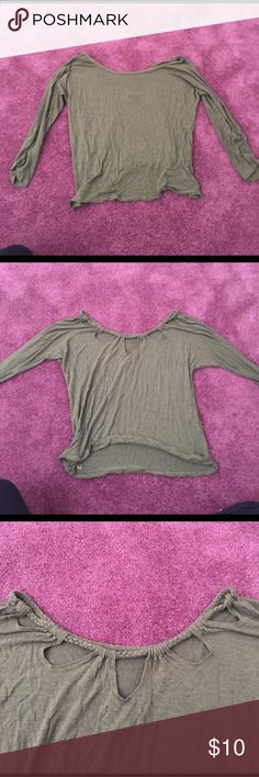 Olive green long sleeve crop top This xs crop too from American eagle is very soft and comfortable. It's form fitting in the arms and flowy in the body area. The back is also very cute! American Eagle Outfitters Tops Crop Tops