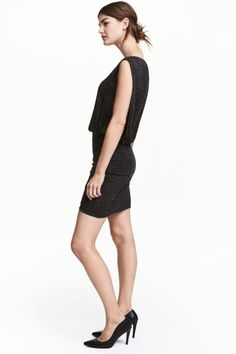 MAMA Glittery nursing dress: Short, fitted, sleeveless dress in marled jersey containing glittery threads with a double layer at the front and deep armholes for easier nursing access. Low-cut neck, draped, wrapover back, seam at the waist and wrapover skirt that is doubled at the front.