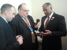 """Action Shot:  Col. West shows Gene & Russell the """"Next Generation"""" Data Card he created to keep his viewers aware of the misery the Obama Administration has created since taking office.  Listen to the interview on our CPAC Recap!"""