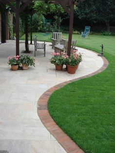 Paving Slab Ideas Cheap Garden Paving Small Patios With . Patios In Havering Essex Outdoor Garden Patio Design. Patio Edging, Brick Edging, Brick Border, Curved Patio, Small Patio, Red Brick Paving, Garden Edging Stones, Driveway Edging, Grass Edging