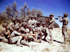 Brazilian soldiers, now in training in Italy, are being instructed on the Bazooka by American soldiers. -