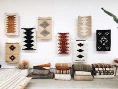 Pampa rug wall ✨ New display for our just landed new collection of Mini Rugs. We are in love with these, I wish I could just keep them all!! Mini Pampa rugs are woven by a group of weavers that can't weave bigger rugs because they are older in age. When presenting this project to them they got really excited about it as it keeps them weaving, close to their loom, to their heritage and traditions.