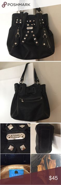 """Kathy Van Zeeland Large Black Bag Kathy Van Zeeland Large Black Bag - Shoulder strap with 11"""" drop and silver colored hardware - Top of Bag has magnetic closure - Interior features three compartments, one name/logo patch, 4 pockets and one with zipper.   - Exterior feature three zippered pockets. - Approx. 12""""H x 14""""W x 5""""D -Soft bag in like new condition.  Gorgeous. Kathy Van Zeeland Bags"""