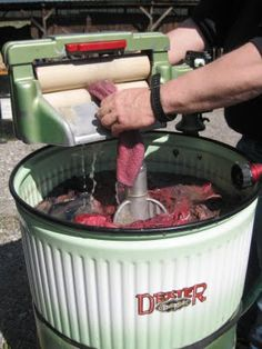 """So for those youngen's who don't know what """"wringer washer"""" really means. The clothes had to be physically fed into the wringer. It literally squeezed the water out. My mom had a wooden stick that she would use to fish the clothes out of the water."""