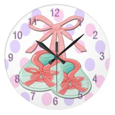 The adorable Girl Baby Booties Round Wall Clock features a light pink, purple and white polka dot background that is customizable, light gre...