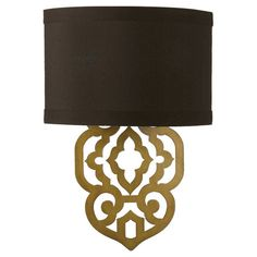 Lend a touch of visual appeal to your entryway or hall with this laser-cut metal wall sconce, showcasing a faux silk shade in brown.