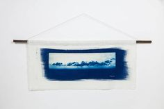 Photography: Cyanotype on Soft (Linen, Fabric). The print features the beautiful landscape of Folegandros, Cyclades, Greece. This photo is part of a serie named Cyclades. The collection was inspired by the authenticity and simplicity of the Greek life style along with the natural beauty of