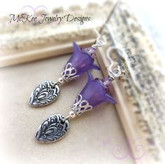 Purple flower earrings. Swarovski crystal, silver flower charms, flowers, sterling silver earrings.