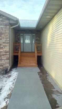 Front entry - sidewalk and railings Wahoo
