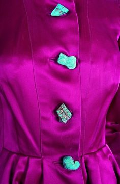 A rare Schiaparelli couture shocking pink coat-dress with chunky turquoise buttons