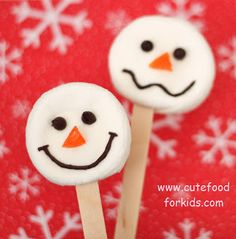 Marshmallow Snowmen Pops  Preheat toaster oven to 225 degrees F  - Insert popsicle sticks into marshmallows, and place them on baking sheet  - Bake the marshmallow pops for 8 minutes or until they look like those marshmallows in the picture on the left side  - Turn the marshmallows upside down carefully  - Place mini chocolate chips on warm marshmallows  - Place gumdrop noses on your snowmen (you may need white cookie icing as glue!)  - Draw mouths with cookie icing