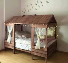 Beautiful girl's playhouse bed! Use different colors and it would be great for a boy's fort bed. This one was made out of well sanded pallet boards with new lumber for the framing.
