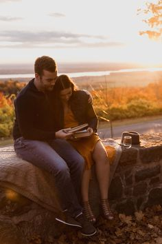 Casual Gatineau Park, Ottawa couples session by Sonia V Photography. Engagement photo shoot outfit ideas, fall colours, wild at heart. Writing love notes to each other.