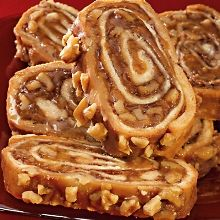 Cinnamon Swirls... Hand-rolled, packed with cinnamon, walnuts, applesauce, topped with chopped walnuts, and baked to a light crisp... Heat, cut, serve... I must figure out a recipe for this.............. YUM!