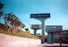 Original Eagle Rock Plaza signage. On the right is the classic marquee for the Eagle Rock Plaza 4 Theatre showing double features of 1998 films (circa February, 1999). DREAMY.