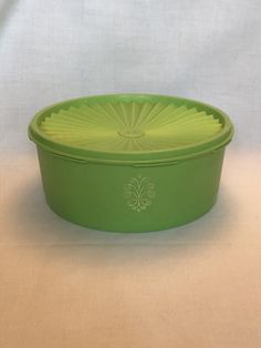 Vintage GREEN Tupperware Servalier serving/storage bowl. This was pre-owned and shows scratches from use. Small melt spot on the side of the bowl and one small nick on one of the ridges on the lid. Otherwise, overall good condition for the items age. Push center to seal lid which fits well onto the Tupperware Canisters, Tupperware Storage, Vintage Green, Etsy Store, Vintage Items, Seal, Harbor Seal, Seals