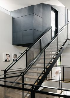 Love the stair rail fabric-ish material, the paintings and black & white color scheme