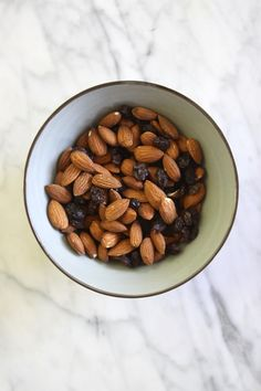 "Healthy Snack: Raw Almonds + Raisins. In a snack-time rut? Click through for food ""pairings"" that will spice things up!"