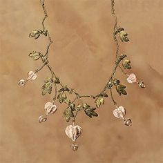 Michael Michaud casts real botanical elements like actual leaves, branches or flower  from herbs, plants, fruits and vegetables in silver and bronze jewelry accented with pearls and gemstones. This bleeding heart necklace is a perfect example of his work!