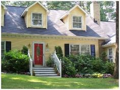 Cape Cod Home with Yellow Siding and a Red Entrance Door 1 1/2 Stories