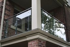 Glass Railing Balcony. By using glass instead of balusters, your balcony will have an open feel adding value and style without compromising your design or view. MirrorGlassDesign.com