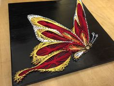 String Art Butterfly Red by StringTheoryVan on Etsy https://www.etsy.com/ca/listing/384470458/string-art-butterfly-red