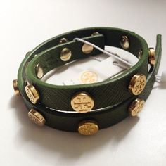 """Tory Burch Logo Bracelet Genuine Tory Burch Leather that offers lustrous texture to a slender wrap bracelet lined with logo-stamped studs 16"""" length; 1/2"""" width. Push closure. Leather/base metal with gold plating. NEW with tags! Doesn't come with dust bag or box, sorry. No trades, PRICE IS FIRM. Bundle to save. Thanks! :) Tory Burch Jewelry Bracelets"""