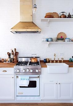 A recent Sneak Peek on Design*Sponge stopped me in my tracks when I saw the kitchen. Farah Malik knew she absolutely wanted a brass hood, and she searched for over a year before she found one on eBay for $200. That, combined with the Viking stove and brass hardware, make for a gorgeous little space.