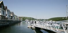 One of the finest marina locations in the West Country – Dart Marina's Yacht Harbour has outstanding facilities and the atmosphere of an exclusive club. Annual berth-holders can enjoy the Health Spa, Restaurant and Fitness Suite of the Dart Marina and take advantage of the setting which is within a stroll of Dartmouth's town centre.