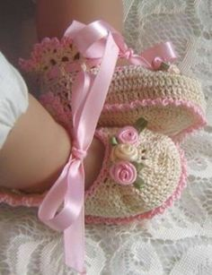 Crocheted baby slippers. Sweet