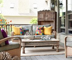Rugs, pillows, and tabletop accessories add style to a plain patio. See more pretty decks: http://www.bhg.com/home-improvement/deck/ideas/dream-decks/?socsrc=bhgpin031313colorfulporch=14