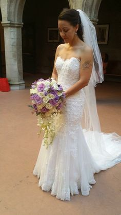 Dress is Tracey by Maggie Sottero, Hair by Soleil Beauty Salon, bouquet by Fashion Flowers