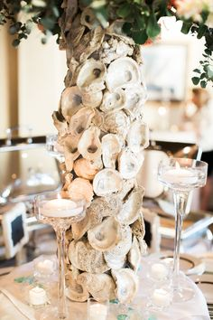 A table centerpiece designed with oyster shells - great idea for a reception on the water!