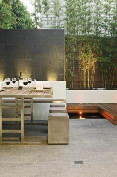 Naturstein Sichtschutzwand Bambus-Blumenkübel Sitzgruppe-gestalten