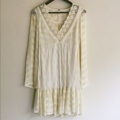 Free People Boho Lace Dress Worn only once. This gorgeous dress is very much on trend giving a 70s vibe. So pretty and feminine. Beautiful lace details cut out back and bell sleeves Free People Dresses