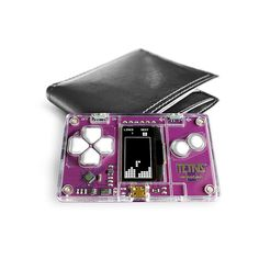 The ultimate on-the-go gaming hardware that fits in your wallet *Tetris® MicroCard* Gadgets And Gizmos, Cool Gadgets, E Textiles, Cool Toys, Technology, Cool Stuff, Games, Product Design, Hardware