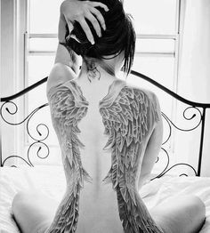 Large angel wings tattoo. If I ever go big and on my back I'll get something like this.