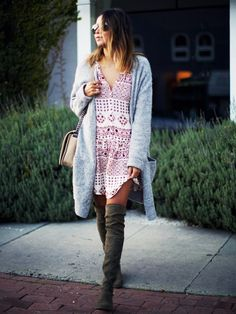 Super Bowl outfit idea: Summery dress with thigh-high boots and an oversized cardigan