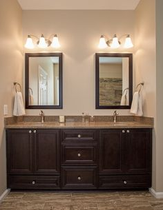 contemporary bathroom by Case Remodeling. Need a vanity half this size but like the dark cabinets, brown countertop/wrap around, dark mirror.