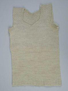 Gebreid borstrok. Dat kriebelde verschrikkelijk wanneer ze van wol waren gemaakt.