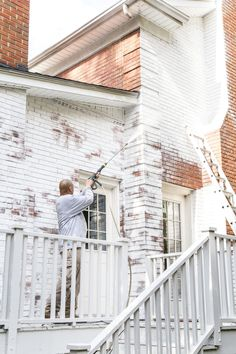 A brick fixer upper colonial house gets a limewashed brick exterior makeover using Romabio Classico Limewash in Bianco White. Painted Brick Exteriors, Colonial House Exteriors, Colonial House Plans, Fixer Upper, Brick Exterior Makeover, White Brick Houses, Grey Houses, White Wash Brick, White Washed Brick Exterior