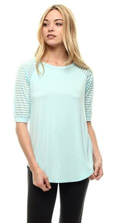 """Jersey Sheer Top We love this top! A """"baseball"""" tee style, the Jersey Sheer top can definitely also be worn dressed up with it's sheer, striped sleeve. The fit is semi fitted and very similar in fit to our ever popular Lexi tee with a mid length sleeve and rounded hem. Super flattering, add this to your essential top collection.  Semi fitted Baseball Tee Style Mid length, sheer sleeve 95% Rayon 5% Spandex"""
