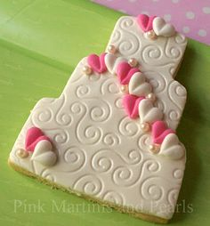 3. Decorated Wedding Cookies. Fondant base with royal icing hearts and pink pearl dragees.