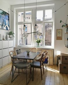 my scandinavian home: Nora's Charming Eclectic Home - the different chairs is an interesting twist