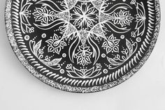 Decorative plate India is perfect for a Christmas gift or for housewarming gift! The plate looks great as a wall decoration - you will love its floral design! This plate was painted by hand and painting is based on Indian motives. Each plate is a bit different!  SIZE: 7.9 diameter (20 cm) MATERIALS: black ceramic plate, acrylic paints, acrylic varnish.  HOW TO USE: * You can put it on a shelf * Hang it on wall (there is a handmade hanger on the opposite size of the plate) * Give it as a…