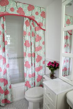 Flower shower curtain with shaped valance and double curtains  room by Design Manifest