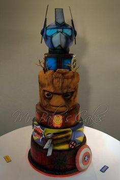 Marvel (and Transformers) Wedding Cake by Mr Baker's Cakes - http://cakesdecor.com/cakes/218298-marvel-and-transformers-wedding-cake